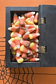 Candy corn in treasure chest for Halloween