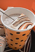 Cocoa with marshmallows in paper cup for Halloween