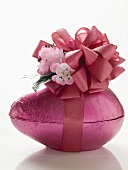 Pink chocolate Easter egg with bow