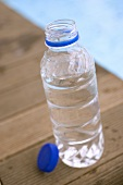 Bottle of water by swimming pool