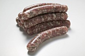 Raw sausages in a pile