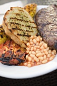 Beef steak with white bread, baked beans & grilled tomato
