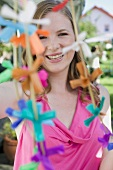 Woman with coloured garlands for a garden party