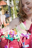 Woman holding basket of decorations for a garden party