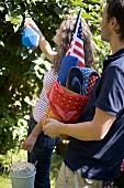 Couple with equipment for a 4th of July picnic (USA)