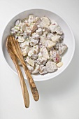Potato salad in a bowl with salad servers