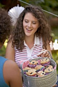 Young women with blueberry muffins on the 4th of July (USA)