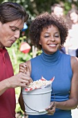 Young people eating popcorn at a garden party