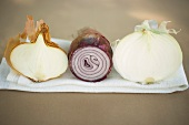 Three different onions, showing cut surfaces