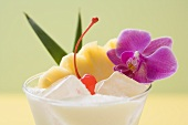 Piña Colada with pineapple, cocktail cherry and orchid