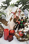 Christmas decorations and two chimney sweeps in snow