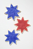 Three star cookies with red and blue icing