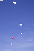 Balloons with letters floating in the sky