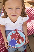 Small girl holding a plate of cookies (4th of July, USA)