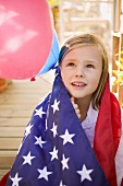 Small girl holding balloons (4th of July, USA)