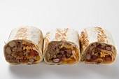 Three wraps filled with mince, beans and cheese