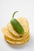 Tortilla chips with green jalapeno chilli