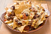 Tortilla chips with melted cheese, beans and mince