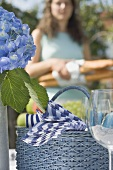 Table laid for a summer party, woman in background