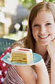 Woman holding a piece of cake on the 4th of July (USA)