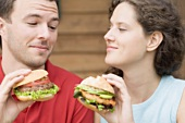 Couple with two different burgers