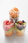 Fresh fruit in four plastic tubs