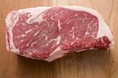Beef steak on wooden background