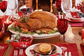Christmas table with turkey in front of fireplace (USA)
