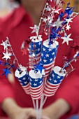 Woman holding decorations for the 4th of July (USA)