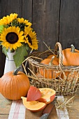 Rustic pumpkin still life with sunflowers