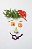 Amusing face made from vegetables and dill