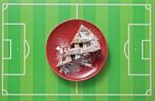 Piece of Linzer torte on artificial football field