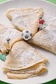 Crêpes with icing sugar, football figures and football