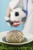 Yeast dumpling with flag, footballer in background