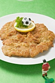 Wiener schnitzel (veal escalope) with football figure & football