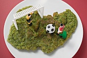 Herb escalope with football figures