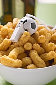 Peanut puffs with football whistle in bowl