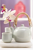 Teapot, tea bowl and orchid