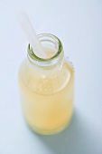 Lemon juice in bottle with straw