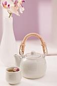 Rose tea in pot and tea bowl