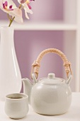 Teapot and tea bowl, orchid in vase
