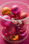 Christmas tree baubles in plastic container