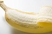 Banana, partly peeled (close-up)