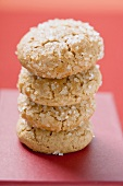 Four sugared biscuits, stacked