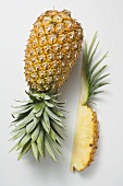Whole pineapple with wedge of pineapple