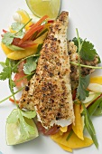 Spicy pangasius fillet with vegetables, lime, coriander