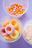 Sugar rings and other sweets in plastic tubs
