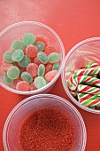 Jelly sweets, candy canes and red sugar