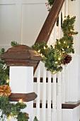 Artistic fir garland on banister rail