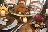 Roast turkey and cranberry sauce on Christmas table (USA)